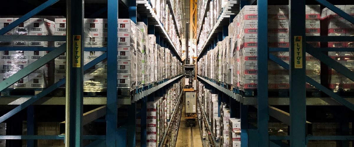 Warehouse aisle with boxes of food on the shelves