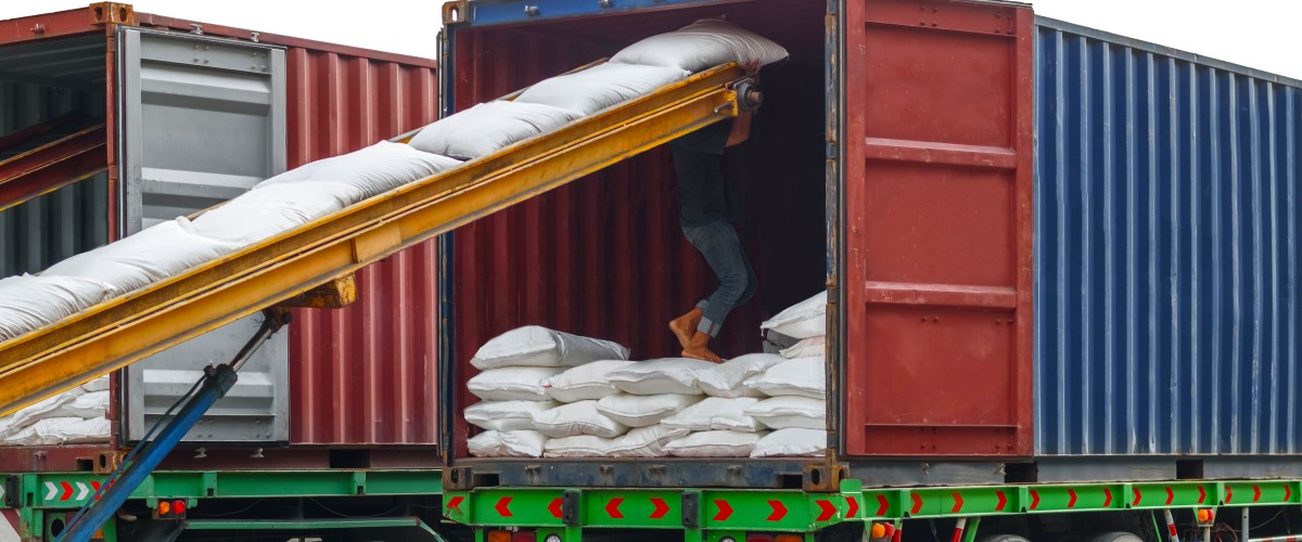 Loading bags of agricultural products into a container